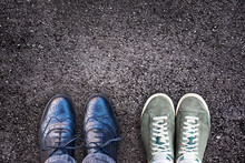 Sneakers And Business Shoes Side By Side On Asphalt, Work Life Balance Concept