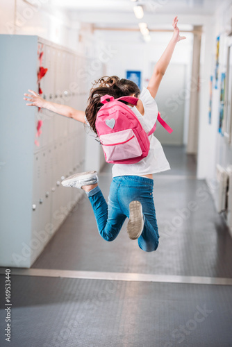 Fotografie, Obraz  girl jumping in school corridor