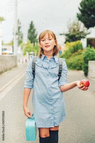 Outdoor Portrait Of Funny Little Schoolgirl Wearing Formal Dress