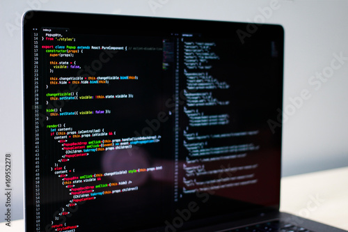 фотография  Frontend developer's laptop screen with some JS code