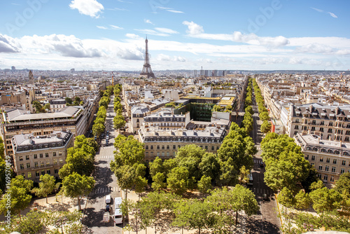 Poster de jardin Paris Aerial wide angle cityscape view on the beautiful buildings and avenues with Eiffel tower on the background during the sunny day in Paris