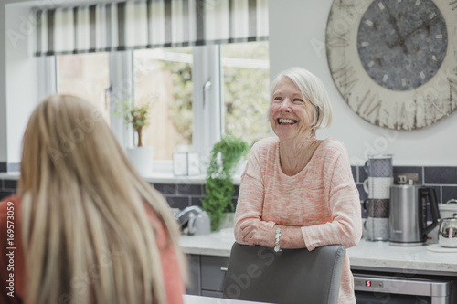 Fotografie, Obraz  Senior Woman Enjoying A Catch Up With Her Daughter