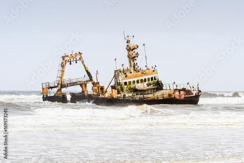 Foto op Canvas Schipbreuk Damaged abandoned ship at the coastline of Namibia