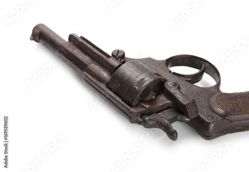 Photo  Old rusty Belgian Great War revolver, Nagant M1873, pistol isolated on white bac