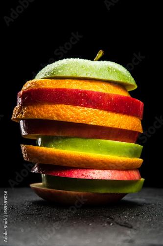 fruit-slices-on-black-backgrou