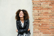 Stylish Laughing Brunette With Afro Embracing Herself