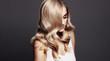 Leinwanddruck Bild - Elegant woman with shiny wavy blond hair