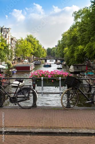 Fototapeta Amsterdam canal scene with bicycles and bridges.. obraz na płótnie