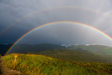 Rainbow at the summit of Mont Ernest Laforce