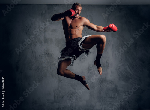 Male fighter in action. Fototapet