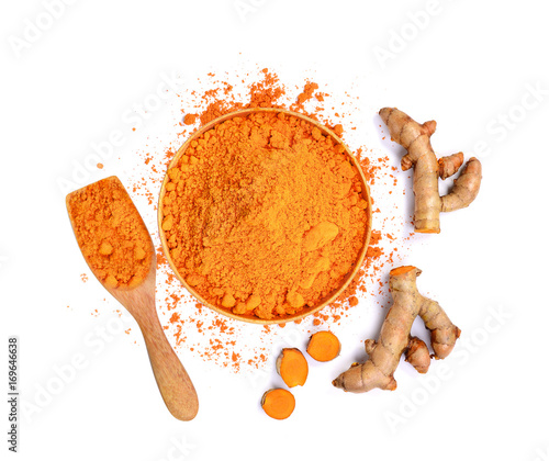 top view of turmeric roots and turmeric powder in wooden bowl isolated on white Canvas Print