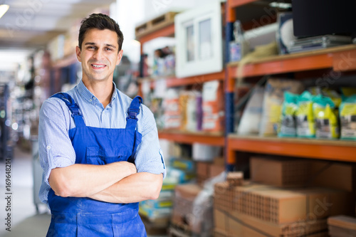 Fotografie, Obraz  Portrait of cheerful man in uniform on his workplace in building store