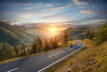 Motorcycle Driver Riding In Alpine Highway. Outdoor Photography, Mountain Landscape.