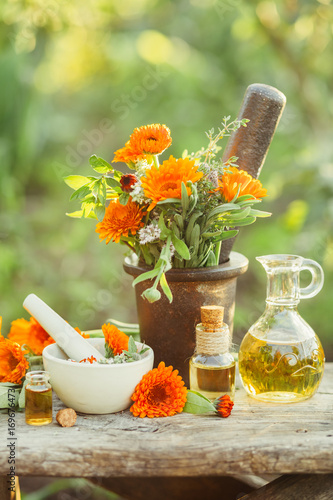 Photo  Fresh herbs, calendula and different types of oils.