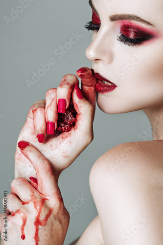 Portrait of beautiful sensual girl with raspberries in hands