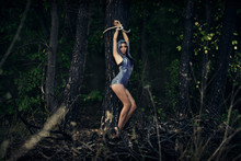 A Girl Tied To A Tree In A For...