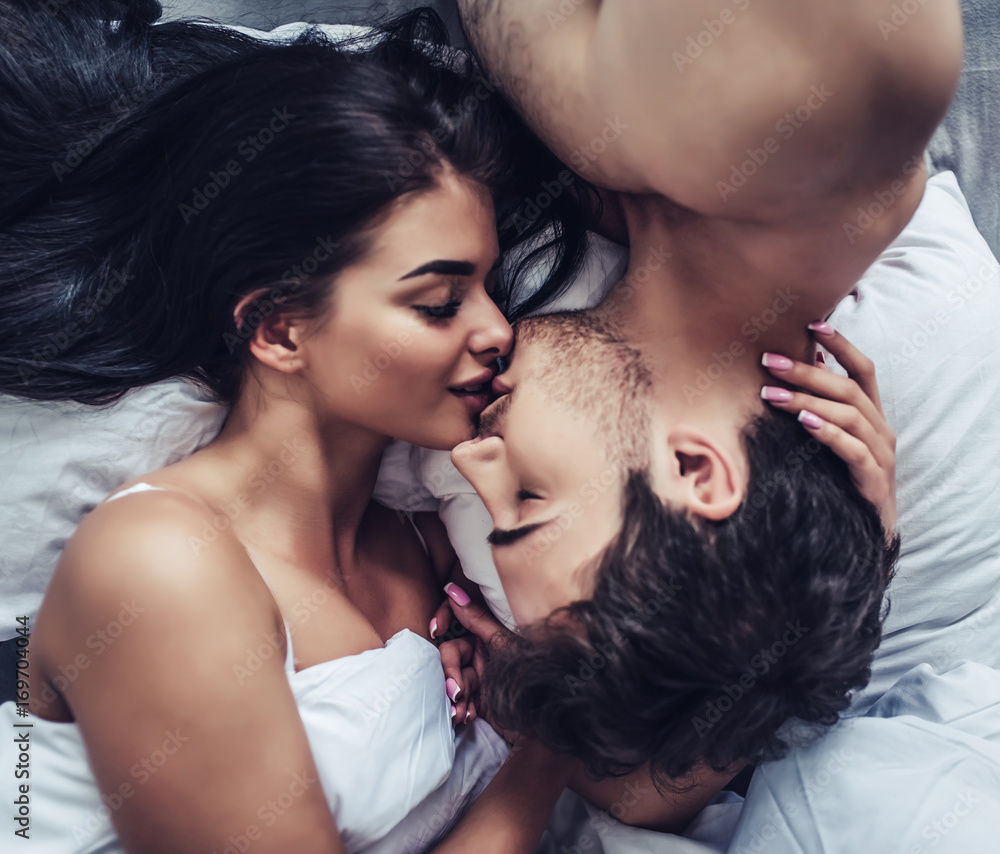 Fototapeta Young love couple in bed