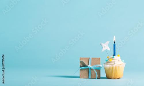 Obraz Cupcake with candle and present box celebration theme - fototapety do salonu