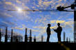 Silhouette images of construction sites are underway and workers are working
