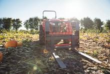 Farm Tractor Parked In Pumpkin Field
