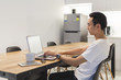 Young Man Working With His Laptop In Startup Environment