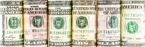 Fotografia  rolls of american dollar banknotes in one row