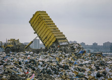 Waste Lorry Tipping Refuse At Landfill Site