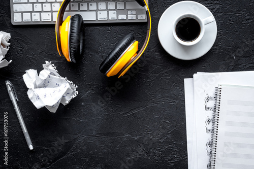 Fotografie, Tablou Desk of musician with headphones for songwriter work on dark background top view