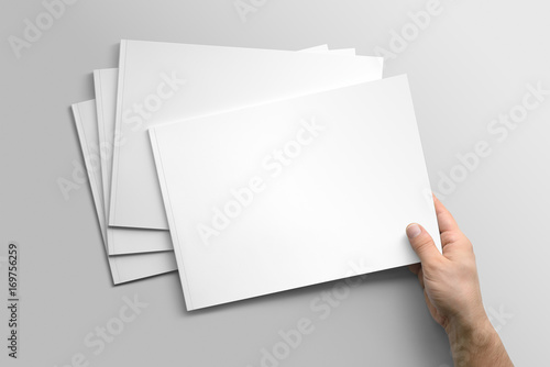 Staande foto Donkergrijs Blank A4 photorealistic landscape brochure mockup on light grey background.