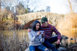 Young couple sitting and relaxing in central park