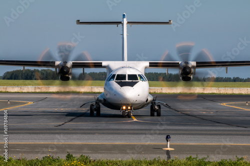 Fotografia, Obraz  Taxiing turboprop airplane from the runway
