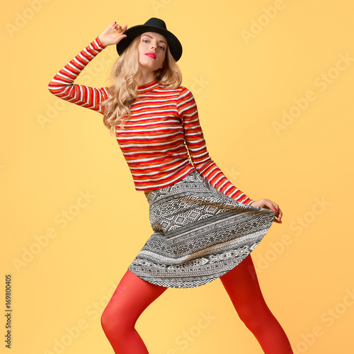 e41ada393b2 Model Woman in Autumn Fashion Outfit Having Fun. Stylish Sweater Trendy Hat  in red fashion pantyhose. Glamour Playful Blonde Sexy girl