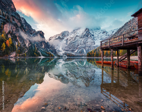 Boat hut on Braies Lake with Seekofel mount on background Wall mural