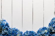 Blue Hydrangea Flowers On A White Wooden Texture Background.Artificial Flowers