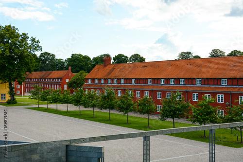 The Copenhagen Citadel (Kastellet), old red buildings in European city Poster