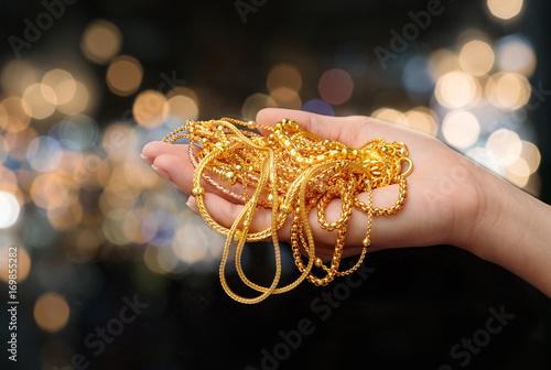 woman hand hold gold bracel...