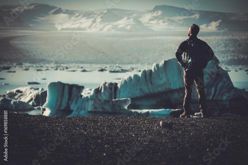 Man explorer lookig at Jokulsarlon lagoon, Iceland. Fototapeta