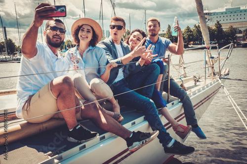 Foto op Canvas Kamperen Happy friends taking selfie on a yacht