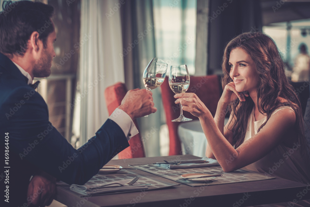Fototapety, obrazy: Beautiful couple in a restaurant