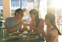 Family Of Three Having Breakfast