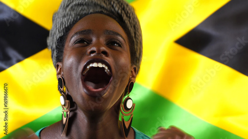 Jamaican Young Black Woman Celebrating with Jamaica Flag Canvas Print