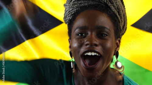 Jamaican Young Black Woman Celebrating with Jamaica Flag Poster Mural XXL