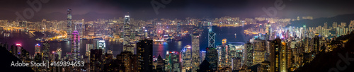 Obraz na płótnie Nocy lekki panoramiczny pejzaż miejski Środkowy okręg i Kowloon, Hong Kong. Sceneria widok z lotu ptaka od szczytowej góry.