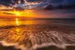 Beautiful sunrise over the sea and waves