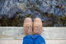 Feet Standing On Wooden Bridge...