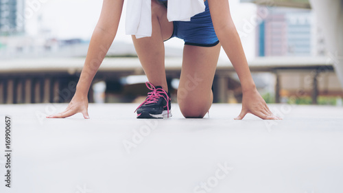 woman runner in starting running position buy this stock photo and
