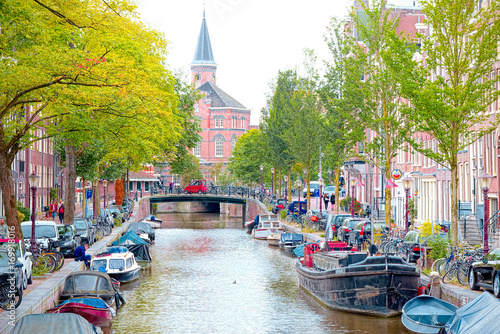 Photo  View of Canals, Houses and Boats in Amsterdam