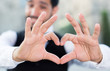 Man gesturing heart with his fingers