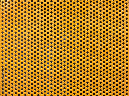 Fotografie, Obraz Yellow metal hole or perforated grid background