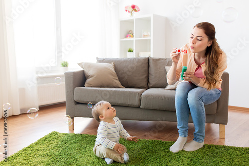 Fototapety, obrazy: mother with soap bubbles playing with baby at home